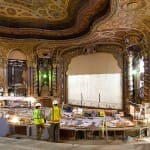 Gilbane team members review plans for Kings Theatre historic restoration construction project.