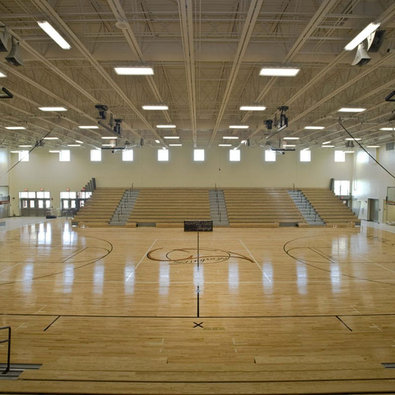 Interior wide angle view of gymnasium.