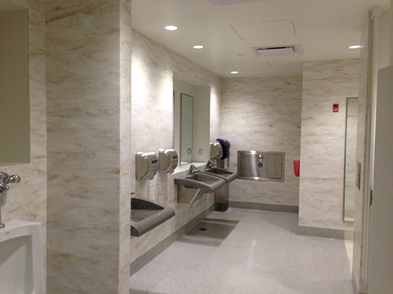High end finishes in the restrooms included terrazzo flooring, solid surface wall panels, and solid surface sinks