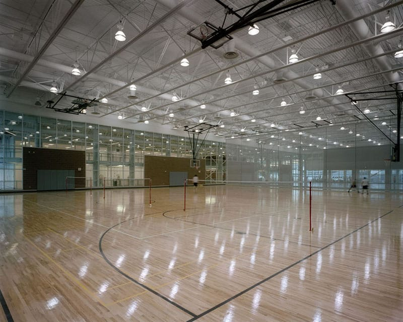 Basketball, volleyball, badminton, racquetball, and squash courts are featured in the building