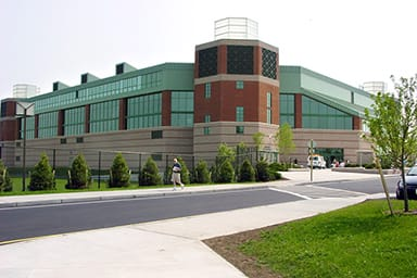 This multi-purpose center's three-tower design invokes visions of Rhode Island's lighthouses and radiates a beacon of light and activity on an active college campus providing a variety of sporting and entertainment events for students, as well as for people in the surrounding communities.