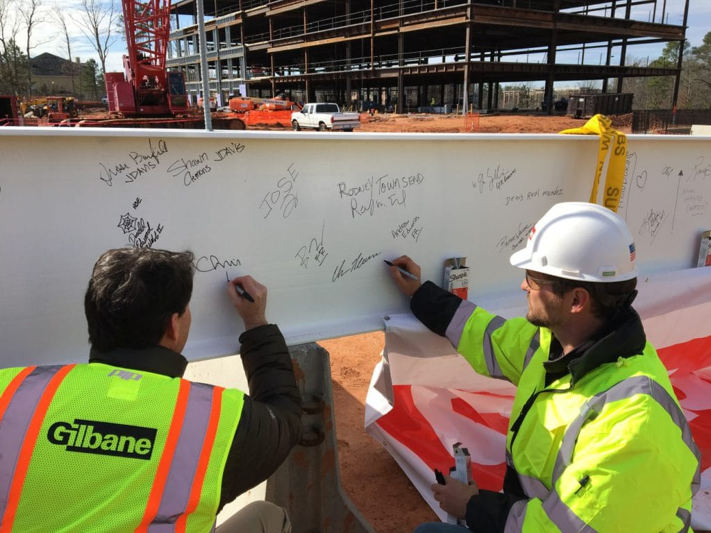 Team signing the final beam before it gets put into place.