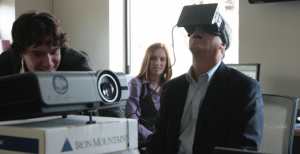 Gilbane's John Myers (left) demonstrates a detailed virtual reality model of the 75/125 Binney Street project in Cambridge, Mass., for architects Robert Schaeffner, AIA, LEED AP, and Hilary Barlow, both with Payette, the design architect for the 382,000-sf business park. - See more at: http://www.bdcnetwork.com/vr-all-how-aec-teams-are-benefiting-commercialization-virtual-reality-tools#sthash.5kN30yMh.7STIGobm.dpuf